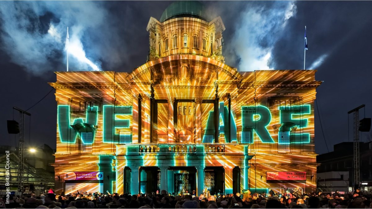 Text and lights projected onto historical building